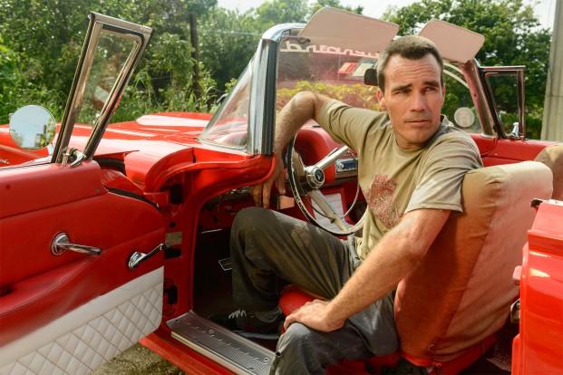 Carlos in his '56 ThunderbirdPhotographer: Michael Coles