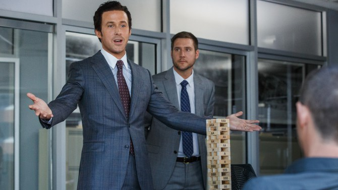 Ryan Gosling plays Jared Vennett and Jeffry Griffin plays Chris in The Big Short from Paramount Pictures and Regency Enterprises